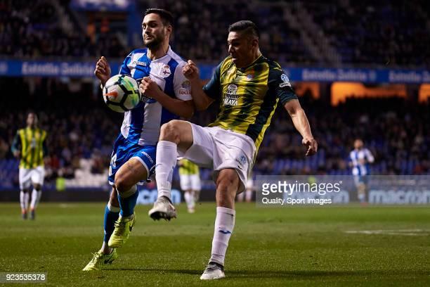 Florin Andone of Deportivo de La Coruna is challenged by Oscar Duarte of RCD Espanyol during the La Liga match between Deportivo La Coruna and...