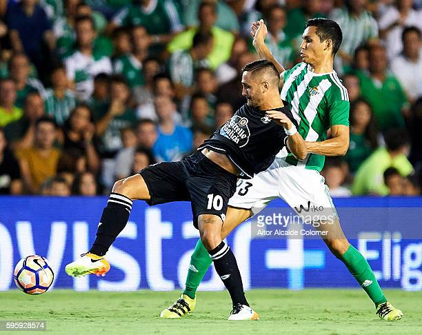 Florin Andone of RC Deportivo La Coruna competes for the ball with Aissa Mandi of Real Betis Balompie during the match between Real Betis Balompie v...