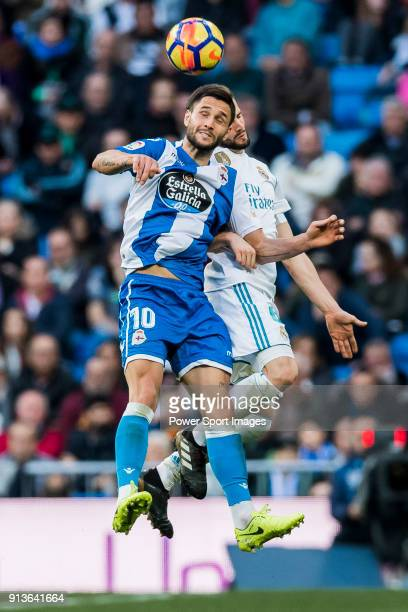 Florin Andone of RC Deportivo La Coruna fights for the ball with Nacho Fernandez of Real Madrid during the La Liga 201718 match between Real Madrid...