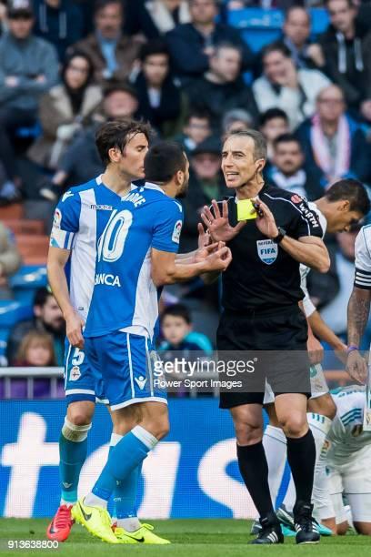 Florin Andone of RC Deportivo La Coruna speaks to referee David Fernandez Borbalan during the La Liga 201718 match between Real Madrid and RC...