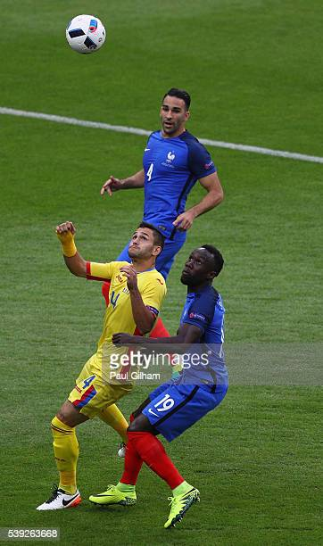 Florin Andone of Romania and Bacary Sagna of France compete for the ball during the UEFA Euro 2016 Group A match between France and Romania at Stade...