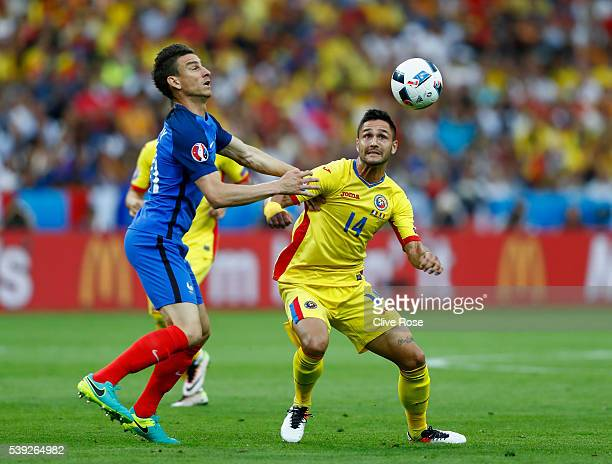 Florin Andone of Romania and Laurent Koscielny of France compete for the ball during the UEFA Euro 2016 Group A match between France and Romania at...