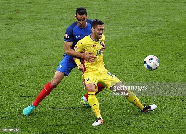 Florin Andone of Romania controls the ball under pressure of Adil Rami of France during the UEFA Euro 2016 Group A match between France and Romania...