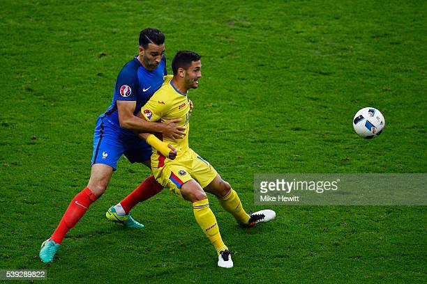 Florin Andone of Romania controls the ball under pressure of Adil Rami during the UEFA Euro 2016 Group A match between France and Romania at Stade de...
