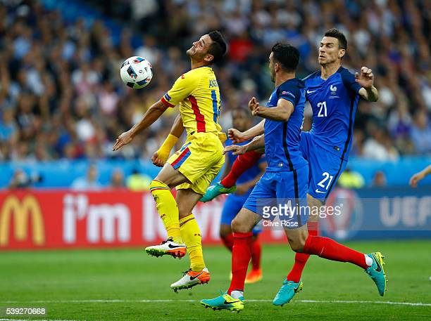 Florin Andone of Romania is challenged by Laurent Koscielny of France during the UEFA Euro 2016 Group A match between France and Romania at Stade de...