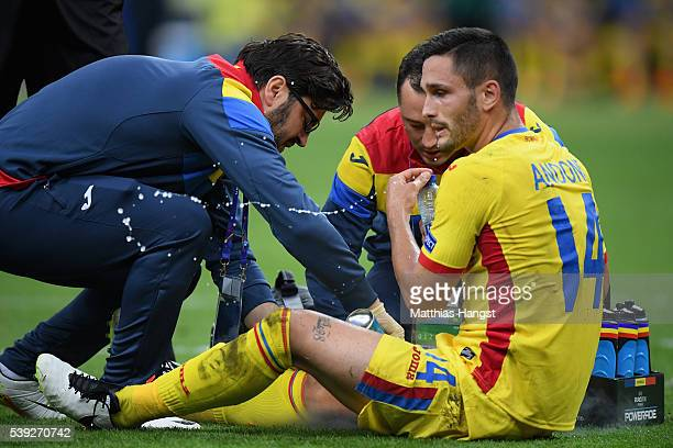 Florin Andone of Romania receives the medical treatment during the UEFA Euro 2016 Group A match between France and Romania at Stade de France on June...
