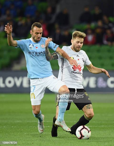 Florin BerenguerBohrer of Melbourne City and Armando Sosa Pena of the Phoenix compete for the ball during the round four ALeague match between...