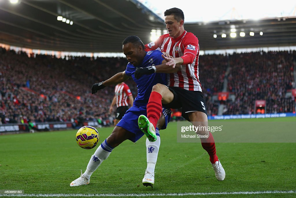 Florin Gardos (R) of Southampton challenges Didier Drogba (L) of Chelsea during the Barclays Premier League match between Southampton and Chelsea at St Mary's Stadium on December 28, 2014 in Southampton, England.