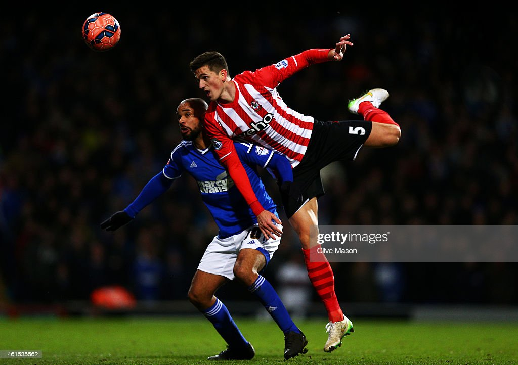 Florin Gardos of Southampton jumps for the ball with David McGoldrick of Ipswich during the FA Cup third round replay match between Ipswich Town and Southampton at Portman Road on January 14, 2015 in Ipswich, England.