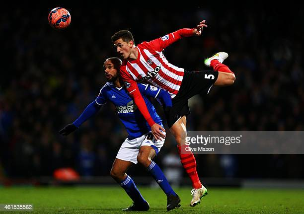Florin Gardos of Southampton jumps for the ball with David McGoldrick of Ipswich during the FA Cup third round replay match between Ipswich Town and...