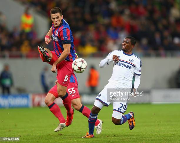 Florin Gardos of Steaua Bucuresti clears from Samuel Eto'o of Chelsea during the UEFA Champions League Group E Match between FC Steaua Bucuresti and...