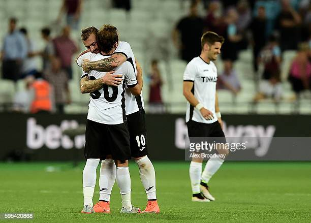 Florin Lovin and Denis Alibec of FC Astra Giurgiu celebrate following the UEFA Europa League match between West Ham United and FC Astra Giurgiu at...
