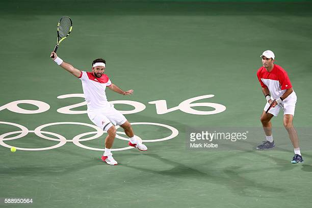 Florin Mergea and Horia Tecau of Romania return a shot against Rafael Nadal and Marc Lopez of Spain during the Men's Doubles Gold medal match on Day...
