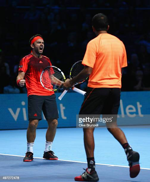 Florin Mergea of Romania and Rohan Bopanna of India celebrate victory after their men's doubles match against Bob Bryan and Mike Bryan of the United...