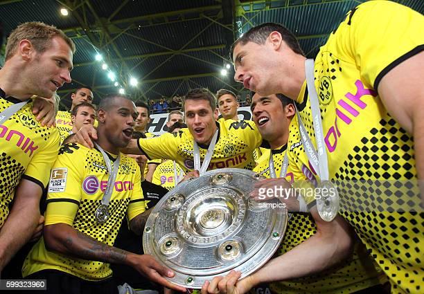 Florina Kringe, Felipe Santana, Sebastian Kehl, Lucas Barrios and Robert Lewandowsk mit Meisterschale Fussball Saison 2011 / 12 1 Bundesliga Borussia...