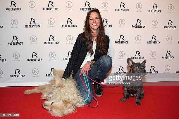 Florinda Bogner and her dogs Kio and Lui during the Rodenstock & Bogner premiere party at P1 on January 9, 2015 in Munich, Germany.