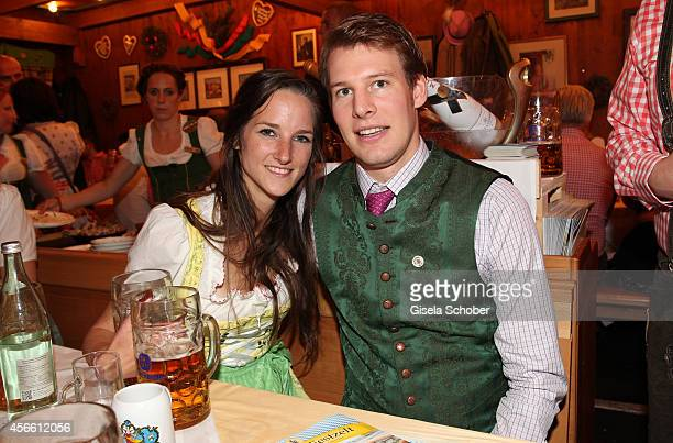 Florinda Bogner , Mathias Reinbold during Oktoberfest at Schuetzenzelt/Theresienwiese on October 3, 2014 in Munich, Germany.