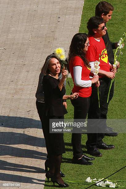 Florinda Meza widow of the late Mexican comedian screenwriter TV producer actor and director Roberto Gomez Bolanos carries flowers during his funeral...