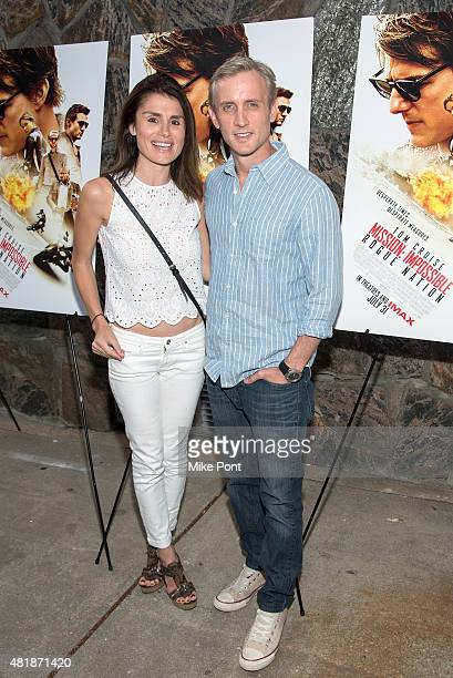 Florinka Pesenti and Dan Abrams attend the Mission Impossible Rogue Nation Hamptons screening at United Artists East Hampton Cinema on July 24 2015...