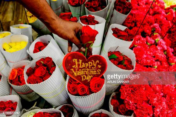 A florist arranges roses flowers at a shop ahead of Valentine's Day in Chennai on February 11 2020