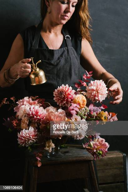 florist arranging flowers - flower arrangement stock pictures, royalty-free photos & images
