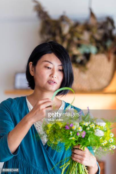 florist at the shop - adult video japan stock pictures, royalty-free photos & images