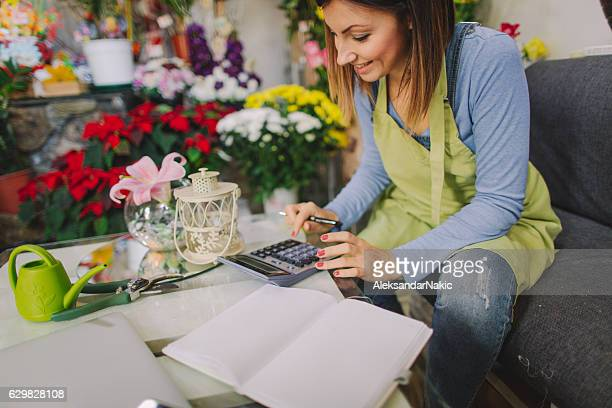 Florist calculating expenses
