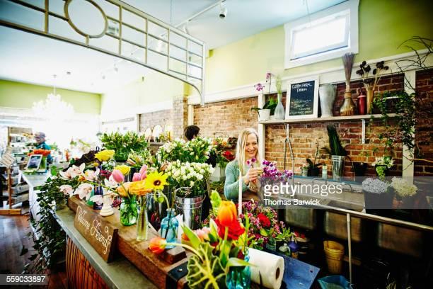 Florist creating arrangement in flower shop