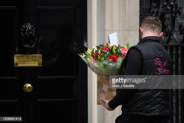 Florist from 'Isle of Flowers' delivers a bouquet for Prime Minister Boris Johnson to 10 Downing Street on April 7, 2020 in London, England. Prime...