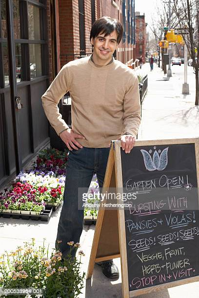 Florist in front of shop, portrait