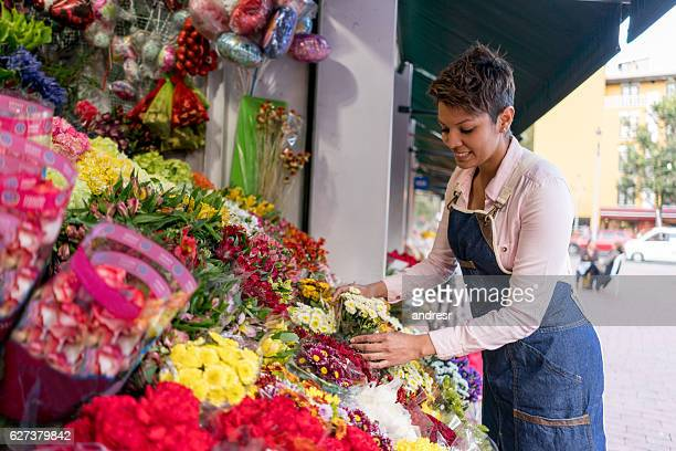 Florist organizing flowers - small business