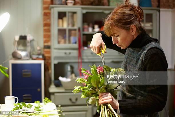 Florist preparing bouquet of flowers