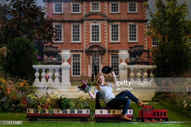 Florist Sarah Richardson poses on a display she decorated aimed at capturing the essence of Newby Hall and Gardens during a staged media photocall on...