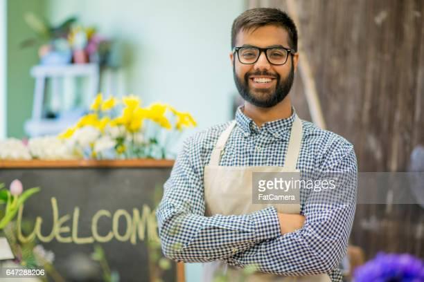 Florist Standing in His Shop