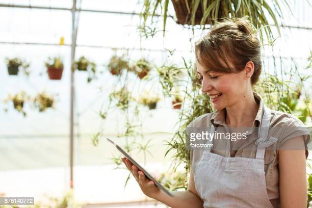 Florist using tablet in plant nursery