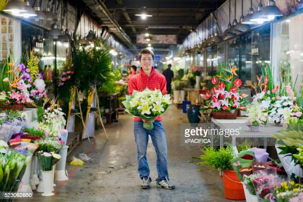 Florist with a bouquet of flowers at a flower shop