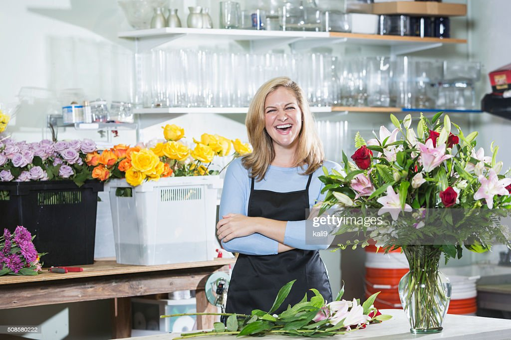Florist working on flower arrangements : Stock Photo