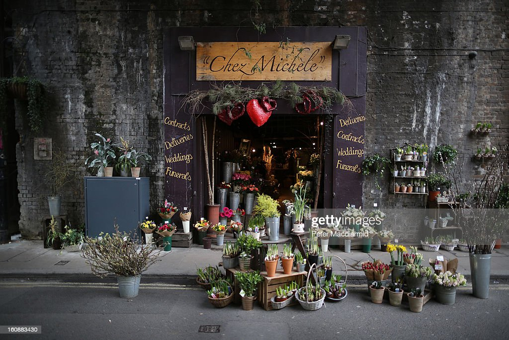 A florist's shop spills out onto the street under a railway bridge at Borough Market on February 7, 2013 in London, England. Borough Market, London's oldest since 1756, has recently completed renovation and today had it's first day of full trading.
