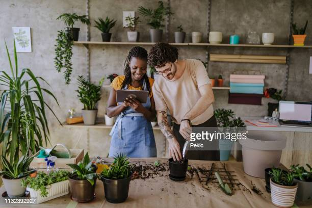 florists using digital tablet - happy merchant stock pictures, royalty-free photos & images