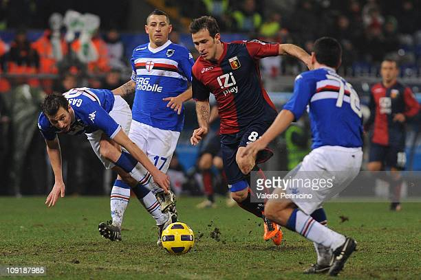 Floro Flores of Genoa CFC in action against Daniele Gastaldello and Angelo Palombo of UC Sampdoria during the Serie A rearranged match between UC...