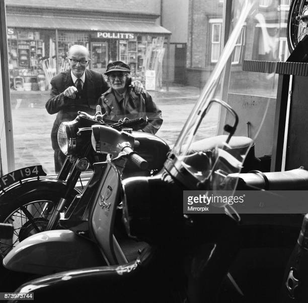 Florrie Ball and her brother Arthur Thompson looking in the window of the a motorbike shop, trying to pick a bike for Florrie, 11th February 1969.