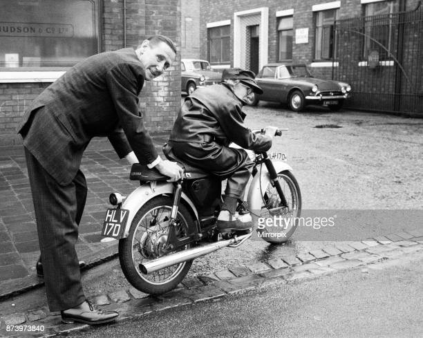 Florrie Ball is given a push off on her new motorbike by insurance broker Arthur Edwards, 11th February 1969.