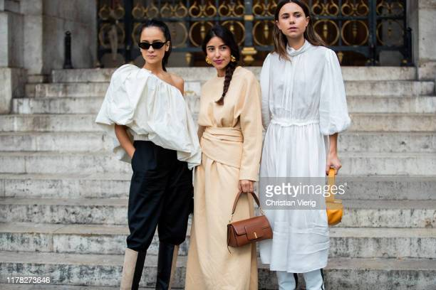 Florrie Thomas wearing white dress, Anna Rosa Vitiello seen wearing white ripped off blouse, black pants, two tone boots and Bettina Looney wearing...