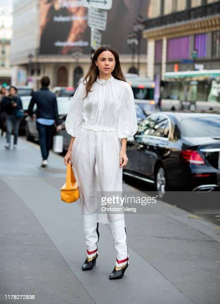 Florrie Thomas wearing white dress outside Stella McCartney during Paris Fashion Week Womenswear Spring Summer 2020 on September 30, 2019 in Paris,...