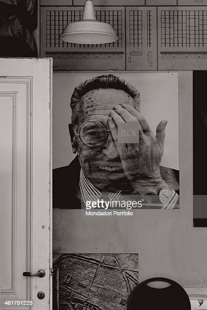 A Flos poster depicting the portrait of Italian architect and designer Achille Castiglioni displayed at his Studio Museum Milan Italy 2013