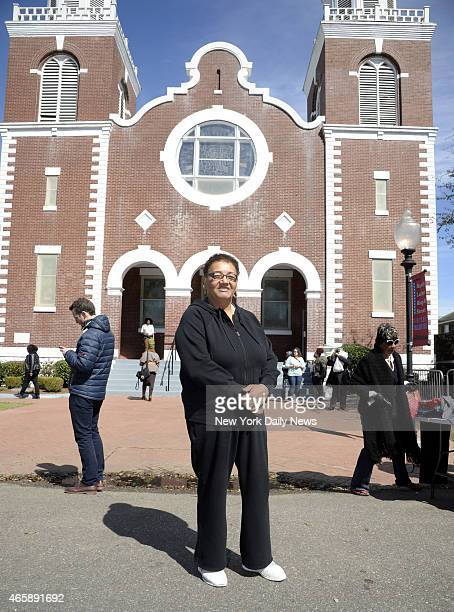 """Flossie Menifee who marched on """"Bloody Sunday"""" in 1965, stands in front of the A.M.E. Church where the march started as she commented on a billboard..."""