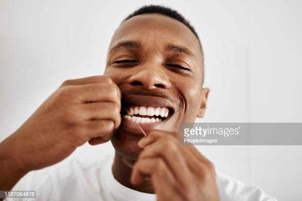 flossing is just as important - dental floss stock pictures, royalty-free photos & images