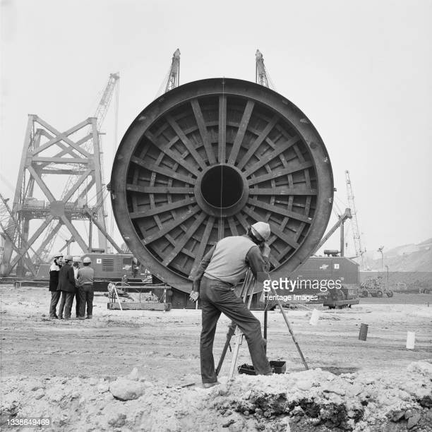 Flotation tank for an oil platform lying in the dry dock at Graythorp and a man carrying out surveying in the foreground. In the early 1970s Laing...