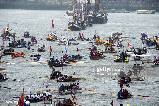 A flotilla of different vessels sails on the River Thames during the Thames Diamond Jubilee river Pageant in London on June 3 as Britain celebrates...