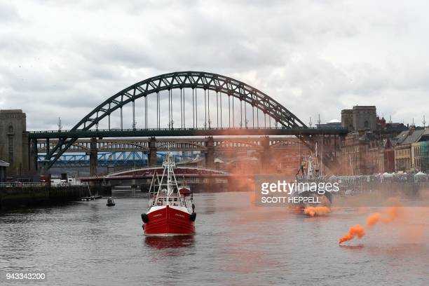 A flotilla of fishing vessels passes under the Tyne Bridge in Newcastle northeast England on April 8 during a protest against the Brexit transition...